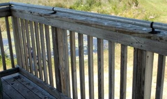 A coyote roller installed on a railing will prevent vultures from perching.