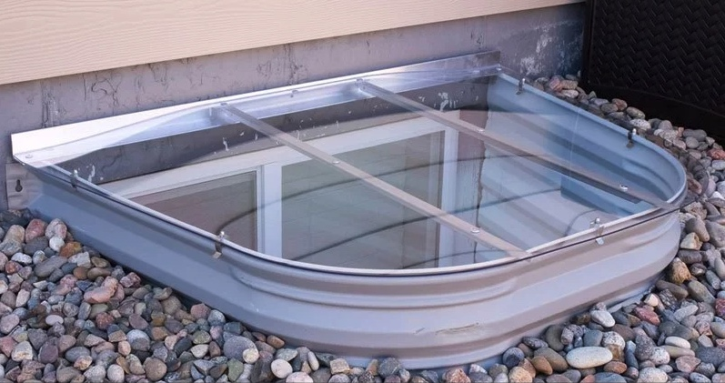 A plastic window well cover.